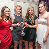 Katie Malone, Orla McMahon, Sophie Hannah and Rae Wall, members of the Éire Óg Ladies Junior A Football Team receiving their medals on the night