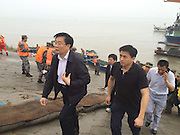 JINGZHOU, CHINA - JUNE 02: (CHINA OUT) <br /> <br /> Wang Guosheng (L), governor of Hubei province, arrives at accident site where a ship carrying 458 people sank on Monday night in Jianli section of the Yangtze River on June 2, 2015 in Jingzhou, Hubei province of China. A passenger ship named Dongfangzhixing (Eastern Star) carrying 458 people, including 406 Chinese passengers, 5 travel agency workers and 47 crew members aboard, according to the administration, sank at around 9:28 p.m. on Monday in the Jianli (Hubei Province) section of the Yangtze River. The captain and the chief engineer in eight people have been rescued and both claimed that the ship sank quickly after being attacked by cyclone. Chinese President Xijinping has ordered a work team of the State Council to rush to the site to guide search and rescue work, and rescue teams of Hubei, Chongqing and relevant parties to carry out all-search efforts and properly handle the aftermath. <br /> ©Exclusivepix Media