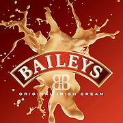 Baileys Irish cream splash behind logo Ray Massey is an established, award winning, UK professional  photographer, shooting creative advertising and editorial images from his stunning studio in a converted church in Camden Town, London NW1. Ray Massey specialises in drinks and liquids, still life and hands, product, gymnastics, special effects (sfx) and location photography. He is particularly known for dynamic high speed action shots of pours, bubbles, splashes and explosions in beers, champagnes, sodas, cocktails and beverages of all descriptions, as well as perfumes, paint, ink, water – even ice! Ray Massey works throughout the world with advertising agencies, designers, design groups, PR companies and directly with clients. He regularly manages the entire creative process, including post-production composition, manipulation and retouching, working with his team of retouchers to produce final images ready for publication.
