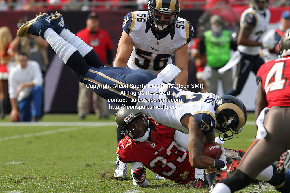 23 December 2012: Rams kick returner Chris Givens (13) goes airborne after being hit by Buccaneers CB Brandon McDonald (33) during the NFL regular season game between the St. Louis Rams and Tampa Bay Buccaneers at Raymond James Stadium in Tampa, Florida.