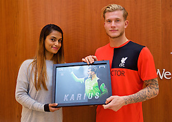 LIVERPOOL, ENGLAND - Friday, December 9, 2016: Liverpool's Emre Can is presented with the Goal.com 25 award by Liverpool correspondent Melissa Reddy at the club's Melwood Training Ground. (Pic by David Rawcliffe/Propaganda)