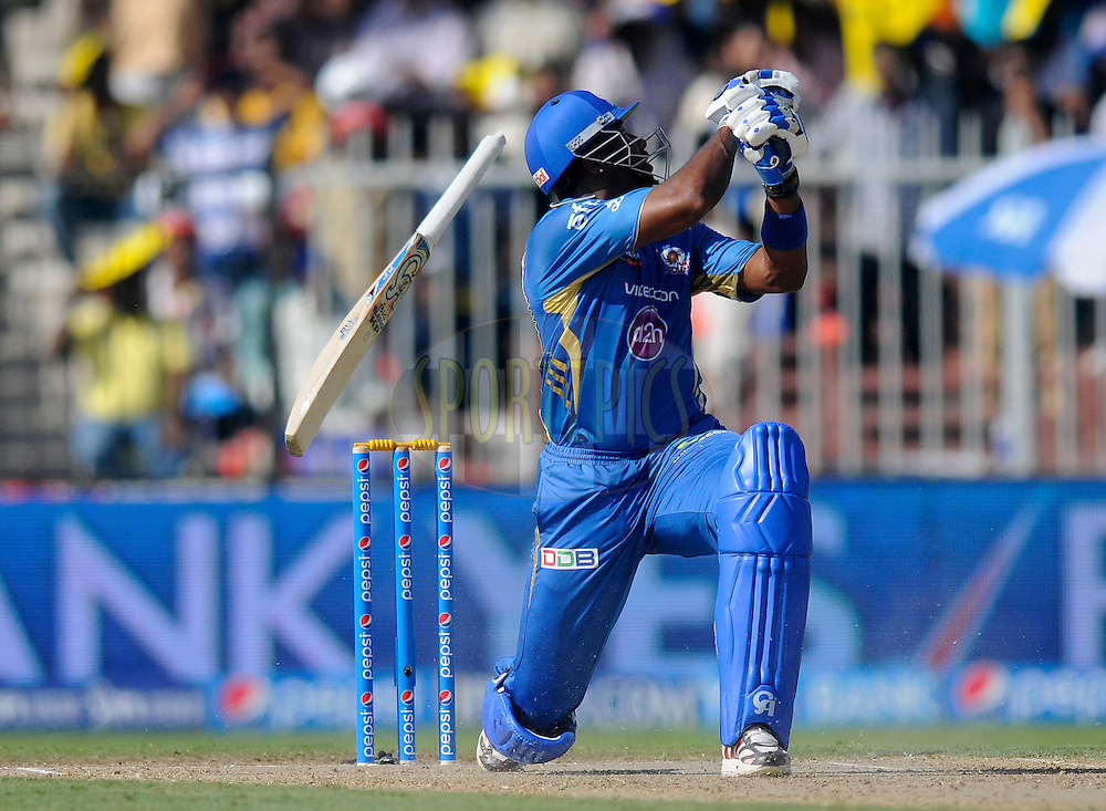Kieron Pollard of the Mumbai Indians looses grip over his bat as he bats during match 16 of the Pepsi Indian Premier League 2014 between the Delhi Daredevils and the Mumbai Indians held at the Sharjah Cricket Stadium, Sharjah, United Arab Emirates on the 27th April 2014<br /> <br /> Photo by Pal Pillai / IPL / SPORTZPICS