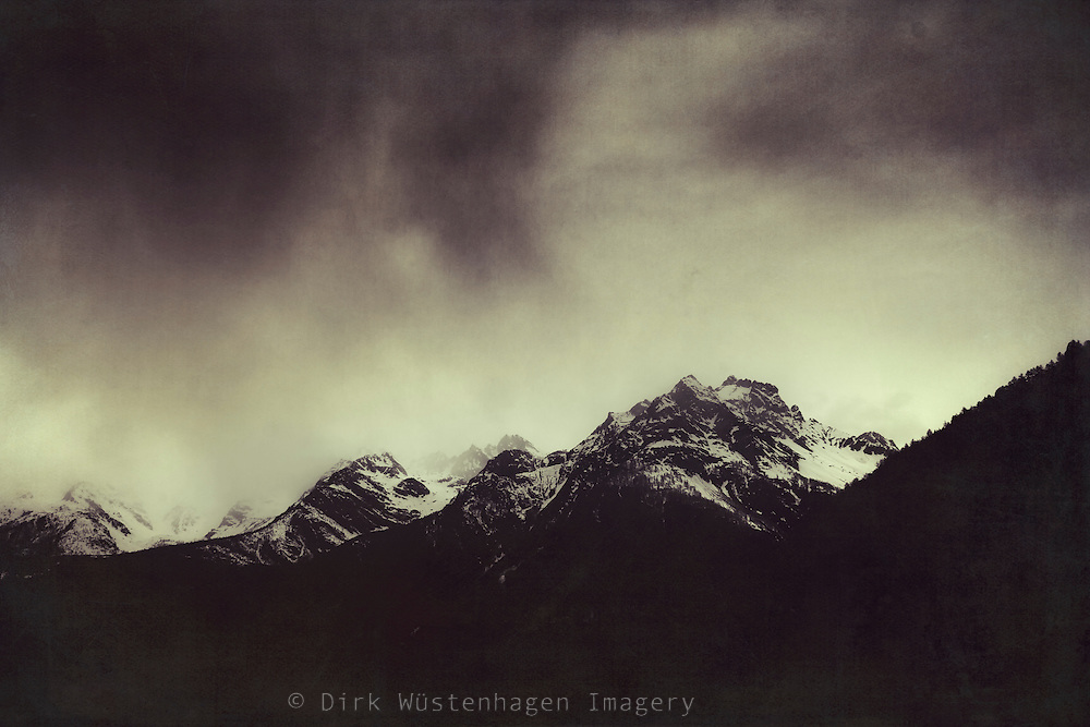 Patches of snow on a cloudy day in the Italian Alps - textured photograph<br /> Society6 products: https://society6.com/product/shadow-mountain-italian-alps_framed-print#12=52&amp;13=54<br /> <br /> REDBUBBLE Prints: http://www.redbubble.com/people/dyrkwyst/works/21009948-shadow-mountains-cloudy-italian-alps