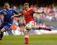 Photo: Leigh Quinnell.<br /> Wales v Slovakia. UEFA European Championships 2008 Qualifying. 07/10/2006. Craig Bellamy has a shot on goal but kind find a way through.
