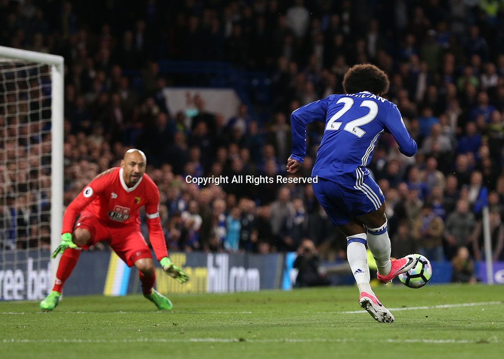 May 15th 2017, Stamford Bridge, London, England; EPL Premier League football, Chelsea FC versus Watford; Willian of Chelsea takes a shot for goal but it is saved by Goalkeeper Heurelho Gomes of Watford