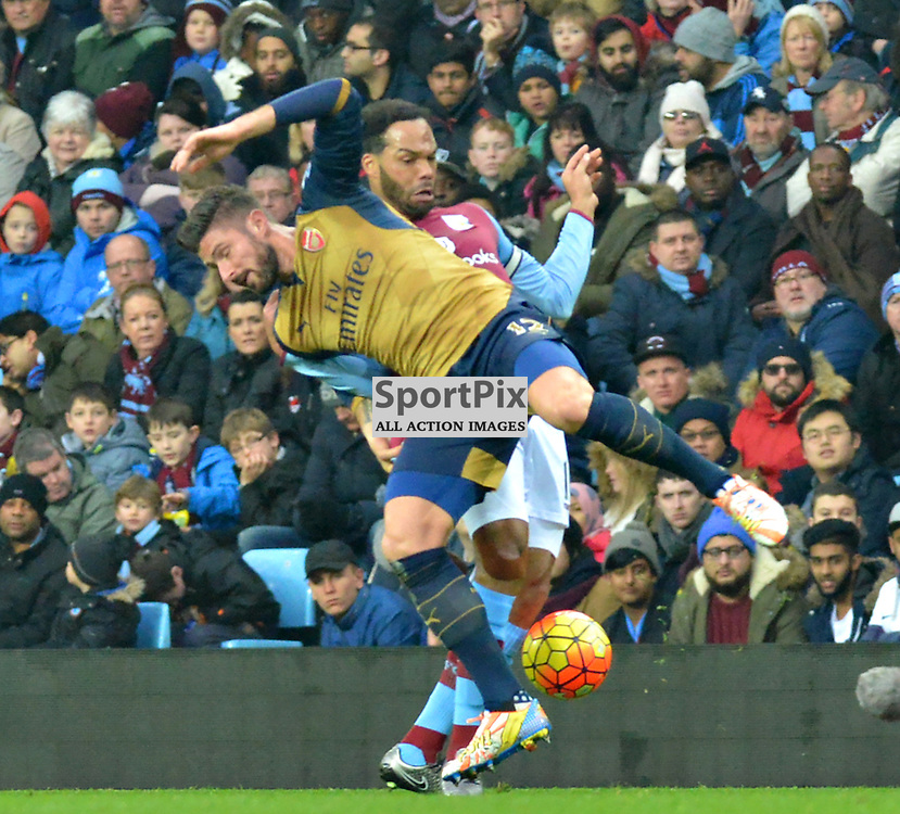 Arsenal's Oliver Giroud and Villa's Joleon Lescott clash at Villa Park.....(c) BILLY WHITE | SportPix.org.uk
