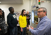 Adjunct Lecturer Ed Fess, Research and Development Manager at OptiPro, speaks to students during an optics class at MCC in Rochester on Thursday, January 22, 2015.