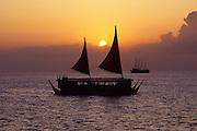 Catamaran at sunset, Waikiki, Oahu, Hawaii<br />
