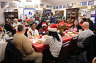 LEVITTOWN, PA -  DECEMBER 15:  Veterans and family members enjoy a holiday dinner for former homeless veterans hosted by the Jewish War Veterans of America - Bristol and partnered with the Levittown Disabled American Veterans - Post 117 December 15, 2013 in Levittown, Pennsylvania. (Photo by William Thomas Cain/Cain Images)