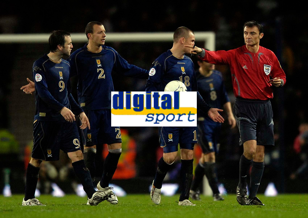 Photo: Jed Wee/Sportsbeat Images.<br /> Scotland v Italy. UEFA European Championships Qualifying. 17/11/2007.<br /> <br /> Referee Manuel Gonzalez (R) waves away protests by Scotland after Italy's late winner.