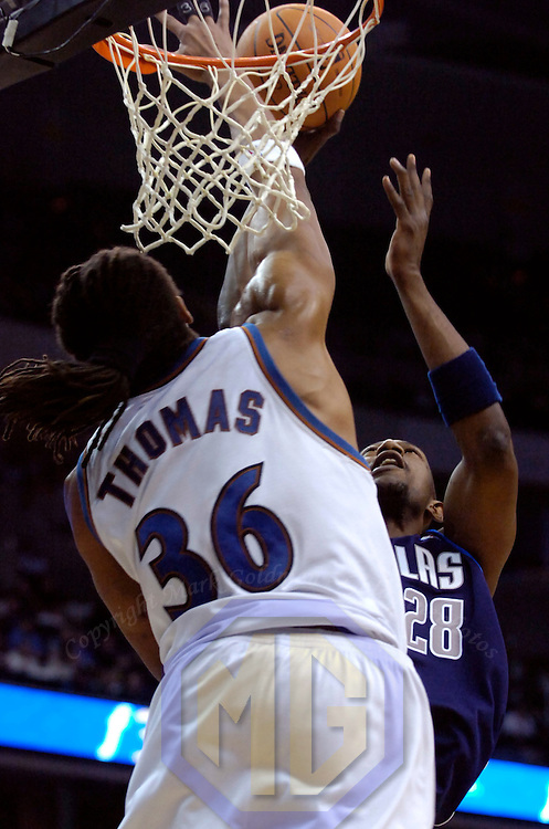 04 December 2006:   The Washington Wizards Etan Thomas (36) blocks a shot taken by the Dallas Mavericks Didier Illunga-Mbenga (28) in the fourth quarter at the Verizon Center in Washington, D.C.  The Wizards defeated the Mavericks 106-97...<br />