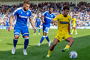 Wycombe Wanderers forward Scott Kashket (11) watched by Gillingham FC defender Max Ehmer (5) during the EFL Sky Bet League 1 match between Gillingham and Wycombe Wanderers at the MEMS Priestfield Stadium, Gillingham, England on 14 September 2019.