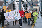 Protestors marched across the Smithfield St. Bridge in attempts to gain support for funding public transtis on November 4th, 2004.