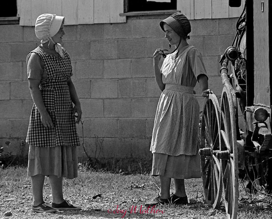 An old-order Mennonite community was established in 1976 by several families who relocated from Pennsylvania to the small town of Liberty in Casey County, Kentucky.  The community allowed me to spend several days there in June of 1980 photographing them with the only stipulation that I couldn't &quot;pose&quot; any photos.   They worked their fields and gardens, did other chores. The whole community went to church on Sunday using an old farmhouse as their place of worship.<br /> <br /> Ruth (Oberholtzer) Kilmer, left.