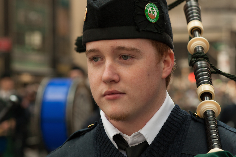 A piper from the Xavieran High School Pipes and Drums.