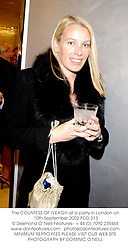 The COUNTESS OF IVEAGH at a party in London on 10th September 2002.PDD 213
