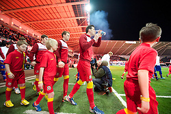 SWANSEA, WALES - Tuesday, March 26, 2013: Wales' Gareth Bale walks out to face Croatia during the 2014 FIFA World Cup Brazil Qualifying Group A match at the Liberty Stadium. (Pic by David Rawcliffe/Propaganda)