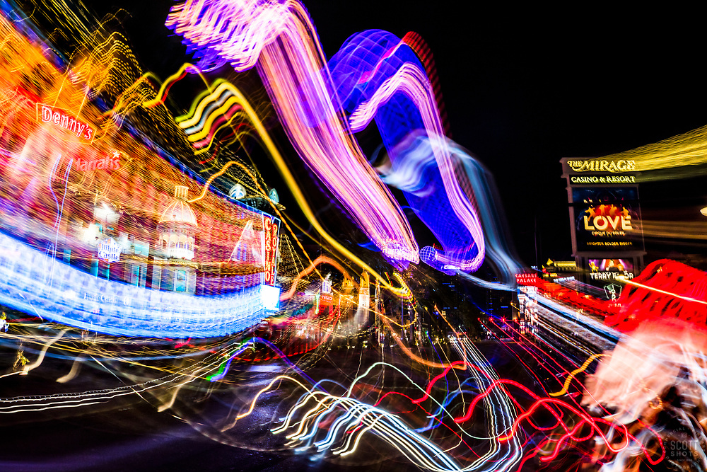 """Las Vegas Lights 8"" - Photograph taken at the Las Vegas, Nevada Strip at night. The look was achieved by shooting a handheld long exposure and zooming the lens during the exposure."