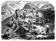 Miners washing for gold using a cradle in the: Californian gold fields. Wood engraving published Paris, 1849, the year of the  Californian Gold Rush.