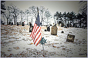 Marker with American Flag in a snow storm