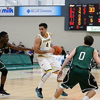 4th year guard Alex Igual (4) of the Regina Cougars in action during the home game on December  2 at Centre for Kinesiology, Health and Sport. Credit: Arthur Ward/Arthur Images