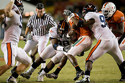 Virginia NT Nate Collins (98) and Virginia defensive end Jeffrey Fitzgerald (95) tackle Miami (FL) wide receiver Darnell Jenkins (8)...The #19 Virginia Cavaliers defeated the Miami Hurricanes 48-0 at the Orange Bowl in Miami, Florida on November 10, 2007.  The game was the final game played in the Orange Bowl.