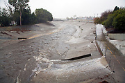 Rain water empties from Storm Pipes into Ballona Creek, a nine-mile waterway that drains the Los Angeles basin. Urban runoff carries an assortment of trash and debris from catch basins where a network of pipes and open channels create a pathway to the Ocean at Santa Monica Bay. Ballona Creek is designed to discharge to Santa Monica Bay approximately 71,400 cubic feet per second from a 50-year frequency storm event. Culver City, Los Angeles, California, USA