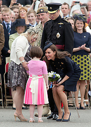 © licensed to London News Pictures. 25/06/2011. Windsor ,UK.  Kate Middleton meets Jessica Harris who gave the royal couple a bunch of flowers. Prince WIlliam and Kate Middleton at Victoria Barracks, Windsor, Berks on Armed Forces day today (25/06/2011) for a Welcome home parade for the Irish Guards following their tour of duty in Helmand province, Afghanistan. See special instructions. Mandatory photo credit: Matt Cetti-Roberts/LNP