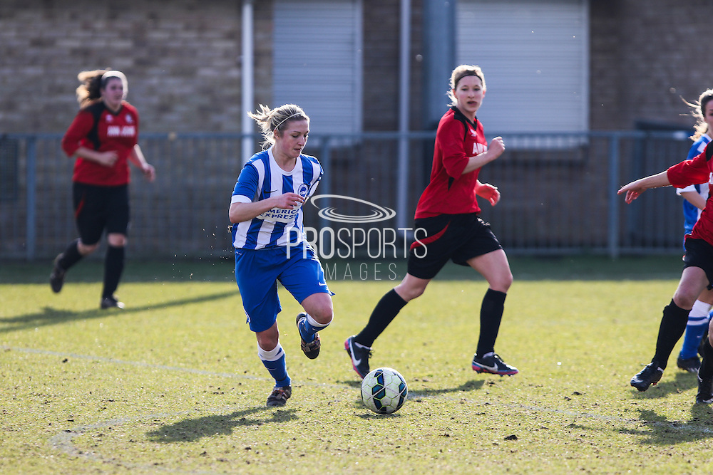 Kirstie Barton attacks the defence during the FA Women's Sussex Challenge Cup semi-final match between Brighton Ladies and Hassocks Ladies FC at Culver Road, Lancing, United Kingdom on 15 February 2015. Photo by Geoff Penn.