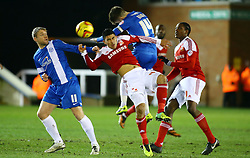 Peterborough United's Tommy Rowe in action with Swindon Town's Massimo Luongo - Photo mandatory by-line: Joe Dent/JMP - Tel: Mobile: 07966 386802 05/02/2014 - SPORT - FOOTBALL - Peterborough - London Road Stadium - Peterborough United v Swindon Town - Johnstone's Paint Trophy