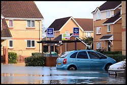 For Sales signs outside homes that are flooded in   Egham, Surrey,  United Kingdom, as floods hit Britain, Thursday, 13th February 2014. Picture by Andrew Parsons / i-Images
