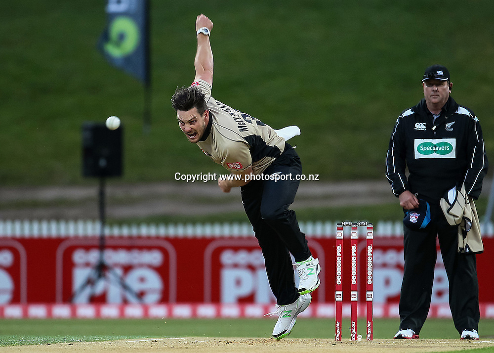 North Island's Mitchell McClenaghan bowling during the Island of Origin T20 cricket game - North v South, 31 October 2014 played at Seddon Park, Hamilton, New Zealand on Friday 31 October 2014.  Photo: Bruce Lim / www.photosport.co.nz