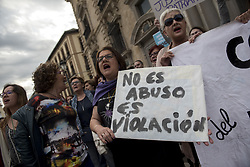 April 26, 2018 - Granada, Granada, Spain - A woman holds a banner saying ''isn´t abuse, it is a rape'' during a demonstration in Granada. People have demonstrated around the country against the judge decision about the judgement of ''La Manada'', five men that raped a young woman during the San Fermines feast in Pamplona in 2016 (Credit Image: © Carlos Gil/SOPA Images via ZUMA Wire)