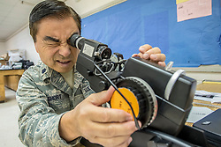 Lt. Col. Ronald Short, an optometrist with the California Air National Guard's 163rd Attack Wing, tests optometry equipment for a health-care clinic at Lee County High School in Beattyville, Ky., June 14, 2018. The clinic is one of four staffed by military health-care professionals in Eastern Kentucky from June 15 to June 24 as part of an Innovative Readiness Training mission called Operation Bobcat. The mission provides military forces with crucial expeditionary training while offering no-cost medical, dental and optometry care to area residents. (U.S. Air National Guard photo by Lt. Col. Dale Greer)