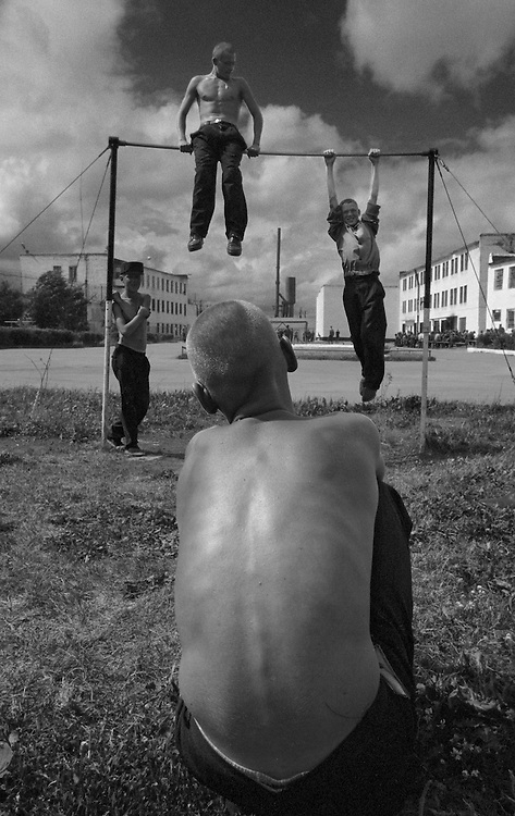 The prisoners rest on the horizontal bar at the colony for prisoner's children in Siberian town Leninsk-Kuznetsky, Russia, 04 July 2001.