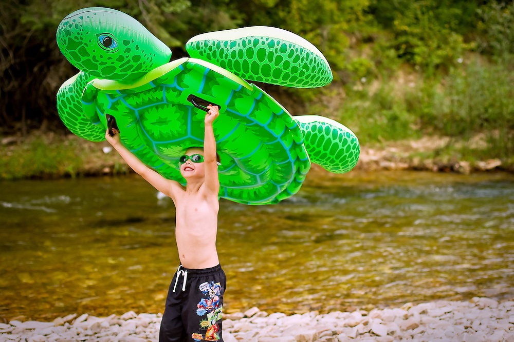 Zachary Wenglikowski carries a large inflatable turtle along the beach during an outing to Little Bumblebee Creek on Sunday, July 11, 2010.