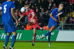 SWANSEA, ENGLAND - Friday, September 4, 2009: Wales' captain Shaun MacDonald and Italy's Giuseppe Bellusci during the UEFA Under 21 Championship Qualifying Group 3 match at the Liberty Stadium. (Photo by Gareth Davies/Propaganda)