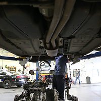 Thomas Wells | BUY at PHOTOS.DJOURNAL.COM<br /> Carl Roebuck has his head buried in the engine bay of a Tupelo Police cruiser he is installing a new engine into at the pulic works repair shop.