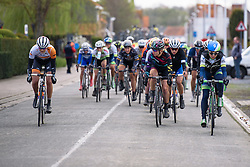 Alexis Ryan carefully watches another break attempt from Jeanne Korevar (Rabo Liv) at Dwars door de Westhoek 2016. A 127km road race starting and finishing in Boezinge, Belgium on 24th April 2016.