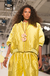 © Licensed to London News Pictures. 31/05/2014. London, England. Collection by Sarah Innes from Edinburgh College of Art. Graduate Fashion Week 2014, Runway Show at the Old Truman Brewery in London, United Kingdom. Photo credit: Bettina Strenske/LNP