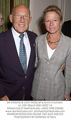 SIR STIRLING & LADY MOSS at a lunch in London on 12th March 2001.	OMC 14