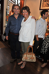 KATE SILVERTON and her husband MIKE HERON at a party to celebrate the launch of the new Mauritius Collection of jewellery by Forbes Mavros held at Patrick Mavros, 104-106 Fulham Road, London SW3 on 5th July 2011.