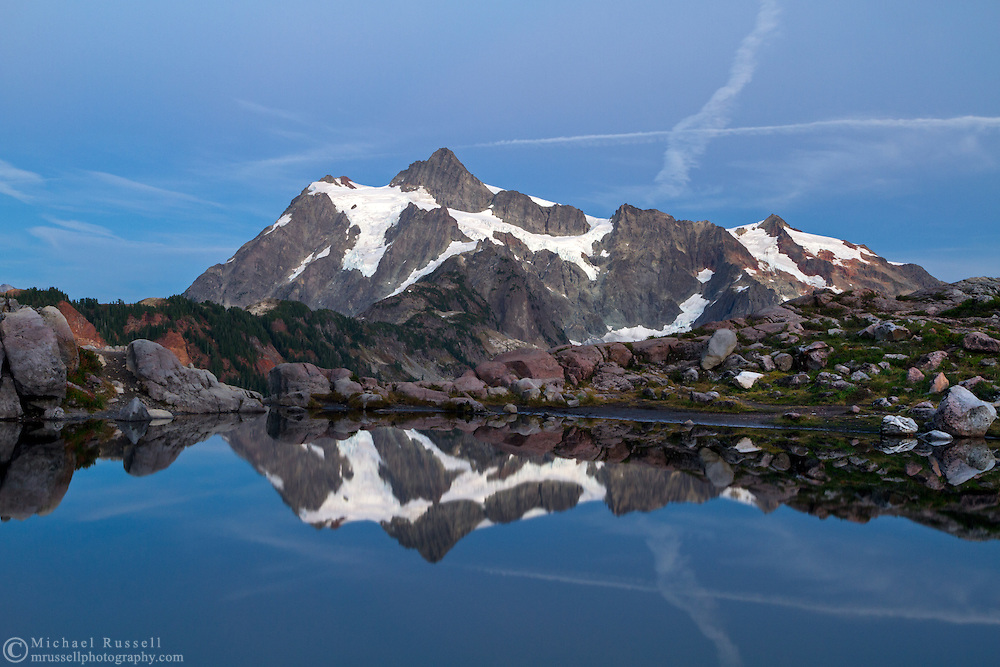 Contrails over Mount Shuksan at the Mount Baker-Snoqualmie National Forest in Washington State, USA