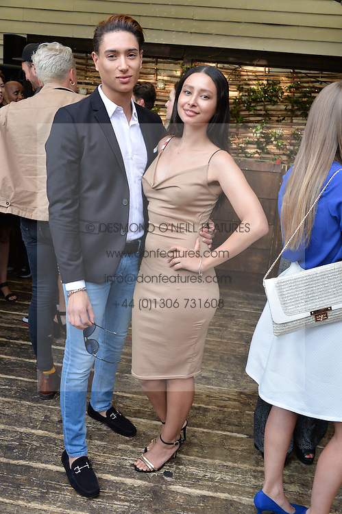 NAT WELLER and LEAH WELLER at the Warner Music Group Summer Party in association with British GQ held at Shoreditch House, Ebor Street, London E2 on 8th July 2015.