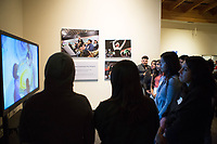 Guests watch video presentations at the December 5th, 2017 opening of the Stories from Salinas exhibition at the CSUMB Salinas Center for Arts and Culture in Oldtown. The exhibition celebrates the mentors, youth and families of the Salinas Youth Initiative.