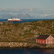 Three weeks aboard the Kong Harald. Hurtigruten, the Coastal Express. Small houses on the coast of Norway in the fjords.