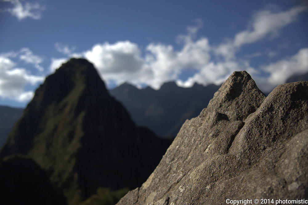 stone carved to match Wayna Picchu in the distance