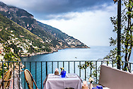 Restaurante Amalfitana, high above the tyrannian sea restaurants and hotels cling to the steep cliffs of the Amalfi Coast in Positano Italy.