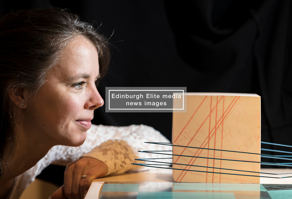 A Fine Line is a group exhibition exploring the fine line between art and craft in two and three dimensions and opens at Edinburgh's City Art Centre on Saturday 18 November 2017 until 18 February 2018.<br />  <br /> A Fine Line features work by four contemporary artists based in Scotland - Lizzie Farey, Angie Lewin, Frances Priest and Bronwen Sleigh, bringing together a diverse range of disciplines including printmaking, drawing, collage, sculpture and ceramics.<br /> <br /> Pictured: City Centre Art Curator, Maeve Toal with Jinja Road Study II by Brownen Sleigh