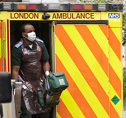 © Licensed to London News Pictures. 13/04/2020. London, UK. An ambulance worker in PPE (personal protective equipment) in Maida Vale, London, during a pandemic outbreak of the Coronavirus COVID-19 disease. The public have been told they can only leave their homes when absolutely essential, in an attempt to fight the spread of coronavirus COVID-19 disease. Photo credit: Ben Cawthra/LNP